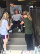 First years learn wheelchair transfers in PT Exam.